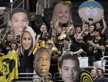 Colorado fans cheer for their team during the first half of an NCAA college basketball game against Utah at the Pac-12 conference championship in Los Angeles, Wednesday, March 7, 2012. (AP Photo/Jae C. Hong)