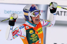United States's Lindsey Vonn celebrates at finish line after winning a women's Alpine Ski World cup giant slalom competition in Are, Sweden, Friday, March 9, 2012. (AP Photo/Alessandro Trovati)