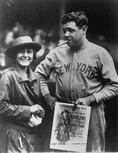 In this rare photo taken in 1923, the legendary Babe Ruth puts the bite on a Girl Scout cookie to help promote the Scout's Annual Cookie Sale.  The photo will be part of a special display of Girl Scout uniforms and memorabilia at the 38th National Antique Show, February 13-21, 1982, at Madison Square Garden.  The National, New York's oldest Antiques Event is setting up this Exhibit to help the Girl Scouts celebrate their 70th Anniversary (1912-1982).(AP PHOTO/MANHATTAN ANTIQUES SHOWS)