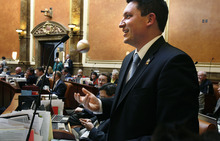 Scott Sommerdorf  |  The Salt Lake Tribune              Rep. Ryan Wilcox, R-Ogden, tosses a baseball while speaking about his bill, HB354 - Alcoholic Beverage Amendments, in the Utah House of Representatives Thursday.