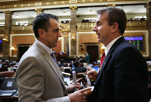 Scott Sommerdorf  |  The Salt Lake Tribune              Rep. Greg Hughes, R-Draper, left, speaks with Rep. Chris Herrod, R-Provo, in the Utah House of Representatives Thursday.