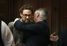 Scott Sommerdorf  |  The Salt Lake Tribune              Sen. John Valentine, R-Orem, gives a hug to Rep. David Litvack, D-Salt Lake, in the Utah House of Representative, Thursday. Litvack had announced he would retire from the House at the end of this session.
