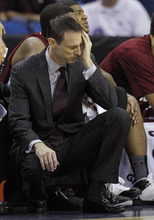 South Carolina head coach Darrin Horn reacts during the first half of an NCAA college basketball game against Alabama in the first round of the 2012 Southeastern Conference basketball tournament at the New Orleans Arena in New Orleans, Thursday, March 8, 2012.  (AP Photo/Bill Haber)