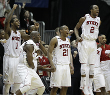 North Carolina State's Lorenzo Brown (2), C.J. Williams (21), DeShawn Painter (0) and Richard Howell (1) reacts in the closing moments of an NCAA college basketball first round game against the Boston College at the Atlantic Coast Conference tournament, Thursday, March 8, 2012, in Atlanta. NC State won 78-57.(AP Photo/Chuck Burton)