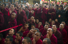 Tibetan Buddhist monks wait for the arrival of Tibetan Buddhist spiritual leader the Dalai Lama to deliver a religious talk on the 15th day of the Tibetan New Year in Dharmsala, India, Thursday, March 8, 2012.  The Dalai Lama has lived in Dharmsala in northern India since fleeing Tibet after a failed 1959 uprising against Beijing's rule. (AP Photo/Ashwini Bhatia)