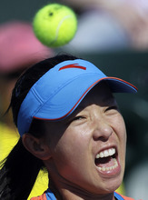 Jie Zheng of China eyes a return to Michaella Krajicek, of the Netherlands, during a match at the BNP Paribas Open tennis tournament Friday, March 9, 2012, in Indian Wells, Calif. (AP Photo/Darron Cummings)