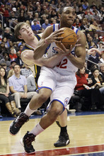 Utah Jazz's Gordon Hayward, left, tries to steal the ball from Philadelphia 76ers' Evan Turner in the first half of an NBA basketball game on Friday, March 9, 2012, in Philadelphia. (AP Photo/Matt Slocum)
