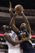 Philadelphia 76ers' Elton Brand (42) fouls Utah Jazz's Al Jefferson (25) who takes a shot in the second half of an NBA basketball game on Friday, March 9, 2012, in Philadelphia. Philadelphia won 104-91. (AP Photo/Matt Slocum)