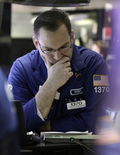 Specialist Anthony Matesic works on the floor of the New York Stock Exchange Wednesday, March 7, 2012. Stocks are edging higher after their biggest loss this year as reassuring reports on productivity and hiring overshadow jitters about the Greek debt crisis. (AP Photo/Richard Drew)