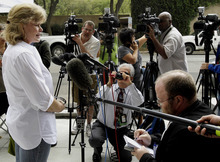 Investor Cassie Wilkinson talks about her financial losses after a guilty verdict was announced on all but one of 14 counts in the fraud trial of financier R. Allen Stanford Tuesday, March 6, 2012, in Houston. Stanford, a former Texas tycoon, whose financial empire once spanned the Americas, was convicted Tuesday for allegedly bilking investors out of more than $7 billion in a massive Ponzi scheme he operated for 20 years.  (AP Photo/Pat Sullivan)