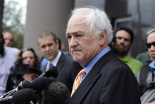 Attorney Robert Scardino talks to the media after a guilty verdict was announced on all but one of 14 counts in the fraud trial of his client financier R. Allen Stanford Tuesday, March 6, 2012, in Houston. Stanford, a former Texas tycoon, whose financial empire once spanned the Americas, was convicted Tuesday for allegedly bilking investors out of more than $7 billion in a massive Ponzi scheme he operated for 20 years.  (AP Photo/Pat Sullivan)