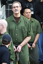 R. Allen Stanford, center, leaves the Bob Casey Federal Courthouse, Tuesday, March 6, 2012, in Houston. Stanford, once considered one of the wealthiest people in the U.S., with a financial empire that spanned the Americas, was convicted Tuesday on charges he bilked investors out of more than $7 billion. (AP Photo/Houston Chronicle, Nick de la Torre)