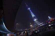 Oriental Pearl Tower is illuminated with blue light to mark Oreo cockie's 100th anniversary celebration in Shanghai, China, Tuesday March 6, 2012. (AP Photo/Eugene Hoshiko)