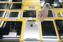 In this March 4, 2012 photo, some iPad-like devices are displayed at a shop in Shanghai, China. Apple's troubles in China over the iPad trademark are not its first, and given its penchant for