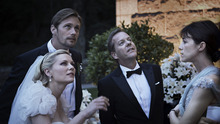 Bride Justine (Kirsten Dunst, left) and her groom Michael (Alexander Skarsgård), with Justine's brother-in-law John (Keifer Sutherland) and sister Claire (Charlotte Gainsbourg), see something in the sky in
