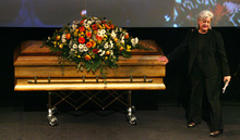 Steve Griffin  |  The Salt Lake Tribune  Meghan Holbrook, former chairwoman of the Utah Democratic Party, touches the casket of Todd Taylor during funeral services Monday for the longtime director. He served under six party chairs and was the longest serving state Democratic Party director in the nation.