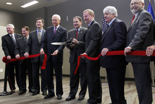 Al Hartmann  |  The Salt Lake Tribune Utah Governor Gary Herbert, center, with Utah Senator Orrin Hatch to his left and others cut the ribbon for the ICBM Building, the first commercial building developed at Falcon Hill National Aerospace Research Park, a massive business park being developed on the west side of Hill Air Force Base.