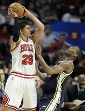 Chicago Bulls forward Kyle Korver (26) looks to pass against Utah Jazz guard Alex Burks (10) during the second half of an NBA basketball game in Chicago, Saturday, March 10, 2012. The Bulls won 111-97. (AP Photo/Nam Y. Huh)