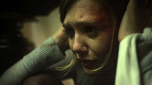 In this film image released by Open Road Films, Elizabeth Olsen is shown in a scene from