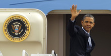 President Barack Obama waves as he boards Air Force One at Andrews Air Force Base, Md., Friday, March 9, 2012. (AP Photo/Ann Heisenfelt)