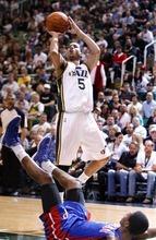 Rick Egan  | The Salt Lake Tribune   Utah Jazz point guard Devin Harris (5) shoots as Detroit Pistons guard Brandon Knight (7) takes a tumble, in NBA action,  Jazz vs. Detroit game, Monday, March 12, 2012.