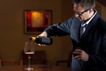 James Santangelo, owner of The Virtual Sommelier, pours a glass of Seghesio's 'Venom,' a Sangiovese, at Donovan's Steak House Thursday September 10, 2009.  Photo by Chris Detrick/The Salt Lake Tribune