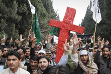 Rahmat Gul  |  The Associated Press Demonstrators chant anti U.S. slogans Tuesday during a protest in Jalalabad east of Kabul, as they carry a red cross following Sunday's killing of 16 civilians by a U.S. soldier.