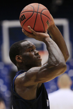 Brigham Young guard Charles Abouo shoots during practice, Monday, March 12, 2012, in Dayton, Ohio. Iona is scheduled to play BYU on Tuesday in a first-round NCAA college basketball tournament game. (AP Photo/Al Behrman)