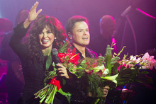 Marie Osmond, left, and Donny Osmond appear at the curtain call for the opening night performance of