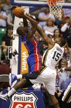 Rick Egan  | The Salt Lake Tribune   Detroit Pistons point guard Rodney Stuckey (3) shoots as Utah Jazz power forward Derrick Favors (15) defends, in NBA action,  Jazz vs. Detroit game, Monday, March 12, 2012.
