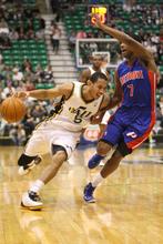 Rick Egan  | The Salt Lake Tribune   Utah Jazz point guard Devin Harris (5) drives on Detroit Pistons guard Brandon Knight (7), in NBA action,  Jazz vs. Detroit game, Monday, March 12, 2012.