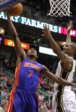Detroit Pistons guard Brandon Knight (7) drives for a shot past Utah Jazz guard Raja Bell, right, during the first half of an NBA basketball game Monday March 12, 2012, in Salt Lake City.  (AP Photo/Jim Urquhart)