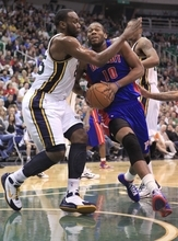 Detroit Pistons center Greg Monroe (10) drives while defended by Utah Jazz center Al Jefferson, left, during the first half of an NBA basketball game Monday March 12, 2012, in Salt Lake City.  (AP Photo/Jim Urquhart)