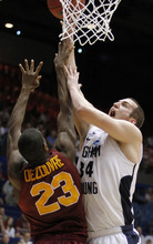 Brigham Young forward Noah Hartsock (34) shoots against Iona forward Randy Dezouvre (23) in the first half of an NCAA men's college basketball tournament opening-round game, Tuesday, March 13, 2012, in Dayton, Ohio. (AP Photo/Skip Peterson)