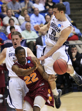 Iona guard Sean Armand (22) passes against Brigham Young forward Brock Zylstra, left, and Matt Carlino (10) in the first half of an NCAA men's college basketball tournament opening-round game, Tuesday, March 13, 2012, in Dayton, Ohio. (AP Photo/Al Behrman)