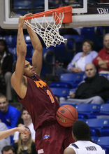 Iona forward Mike Glover (1) dunks against Brigham Young guard Anson Winder in the second half of an NCAA college basketball tournament opening-round game,Tuesday, March 13, 2012, in Dayton, Ohio. (AP Photo/Al Behrman)