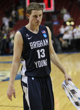 Brigham Young guard/forward Brock Zylstra (13) walks off the court following the second half of their NCAA tournament second-round college basketball game against Marquette in Louisville, Ky., Thursday, March 15, 2012. Marquette beat BYU 88-68. (AP Photo/John Bazemore)