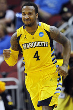 Marquette guard Todd Mayo (4) reacts after making a 3-pointer in the second half of their NCAA tournament second-round college basketball game against BYU in Louisville, Ky., Thursday, March 15, 2012. Marquette won 88-68. (AP Photo/Dave Martin)