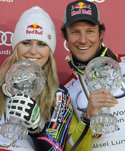 Lindsey Vonn, of the United States, left, and Norway's Aksel Lund Svindal pose with their trophies of the alpine ski, women's and men's World Cup super-G discipline titles, in Schladming, Austria, Thursday, March 15, 2012. Lindsey Vonn won the World Cup super-G title Thursday after narrowly avoiding skiing out and finishing sixth in the final race of the season as Svindal won the World Cup super-G title for a third time Thursday. (AP Photo/Keystone, Jean-Christophe Bott)