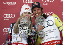 Lindsey Vonn, of the United States, left, and Norway's Aksel Lund Svindal pose with their trophies of the alpine ski, women's and men's World Cup super-G discipline titles, in Schladming, Austria, Thursday, March 15, 2012. Lindsey Vonn won the World Cup super-G title Thursday after narrowly avoiding skiing out and finishing sixth in the final race of the season as Svindal won the World Cup super-G title for a third time Thursday. (AP Photo/Armando Trovati)