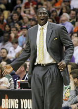 Utah Jazz head coach Tyrone Corbin argues with officials in the second quarter of an NBA basketball game against the Phoenix Suns Wednesday, March 14, 2012, in Phoenix. (AP Photo/Ross D. Franklin)