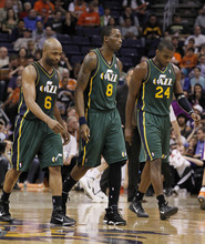 Utah Jazz's Jamaal Tinsley (6), Josh Howard (8), and Paul Millsap (24) walk dejectedly back to the bench in the closing moments in the fourth quarter of an NBA basketball game against the Phoenix Suns Wednesday, March 14, 2012, in Phoenix.  The Suns defeated the Jazz 120-111.(AP Photo/Ross D. Franklin)