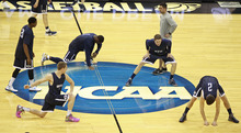 BYU warms up during basketball practice in Louisville, Ky. Wednesday, March 14, 2012. BYU is scheduled to play Marquette in an NCAA tournament second-round college basketball game on Thursday.(AP Photo/John Bazemore)