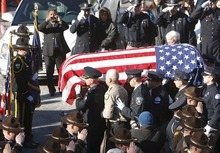 Leah Hogsten | The Salt Lake Tribune   Members of the Ogden Police Department carry the casket of Ogden police Officer Jared Francom. Joined by law enforcement officers statewide, the family and friends of slain Ogden police Officer Jared Francom said farewell during Wednesday, January 11, 2012 funeral services.