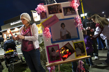 Chris Detrick  |  The Salt Lake Tribune Along with community members, friends and family members, Kendra Gallegos attends a candlelight vigil for Ambrosia Amalathithada at State Street and Kensington Avenue Friday March 16, 2012.  Amalathithada was killed in the crosswalk on Wednesday afternoon on her way home from school with her mom.