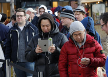 Al Hartmann  |  The Salt Lake Tribune Apple fans use previous Apple devices to pass time as they lined up in front of the Apple Store at The Gateway in Salt Lake City early Friday to be among the first to buy  the new iPad when the store opened at at 8 a.m.