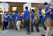 Al Hartmann  |  The Salt Lake Tribune Gateway Apple Store employees in Salt Lake City applaud and give