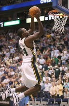 Paul Fraughton | The Salt Lake Tribune.  Paul Millsap gets the inbounds pass but misses the shot that would have won the game for the Jazz in regulation.The Utah Jazz played the Minnesota Timberwolves at Energy Solutions Arena.  Thursday, March 15, 2012