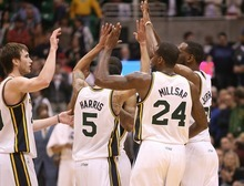 Paul Fraughton | The Salt Lake Tribune. As the clock winds down in the overtime  period, Jazz players give each other high fives as the Jazz defeated the Timberwolves  111 to 105. The Utah Jazz played the Minnesota Timberwolves at Energy Solutions Arena.  Thursday, March 15, 2012