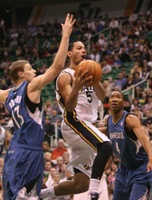 Paul Fraughton | The Salt Lake Tribune. Utah's Devin Harris flies between Minnesota's Luke Ridnour and Wesley Johnson on his way to the basket. The Utah Jazz played the Minnesota Timberwolves at Energy Solutions Arena.  Thursday, March 15, 2012